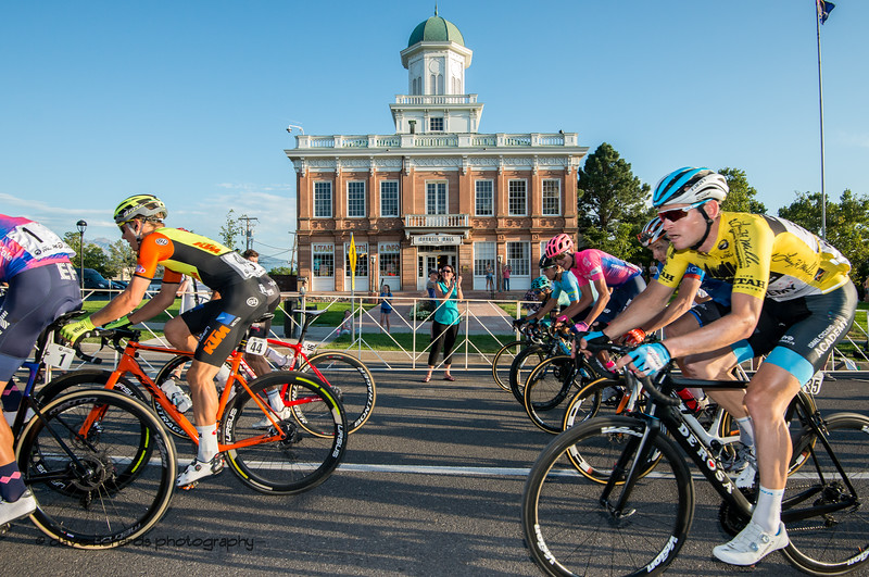 The historic Council Hall building forms the backdrop as the Yellow Jersery rider rolls by. Stage 4 - Salt Lake City Circuit Race, 2019 LHM Tour of Utah (Photo by Dave Richards, daverphoto.com)