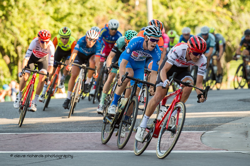 The peloton pushes hard through the corner onto South Temple Street. Stage 4 - Salt Lake City Circuit Race, 2019 LHM Tour of Utah (Photo by Dave Richards, daverphoto.com)