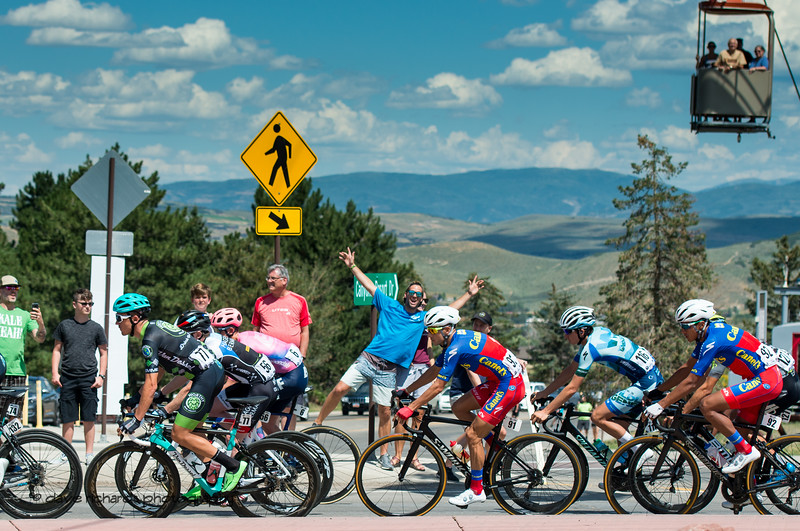 The fans are excited while the gondola passengers watch from above. Stage 5 - Canyons Village Park City Mountain Resort, 2019 LHM Tour of Utah (Photo by Dave Richards, daverphoto.com)