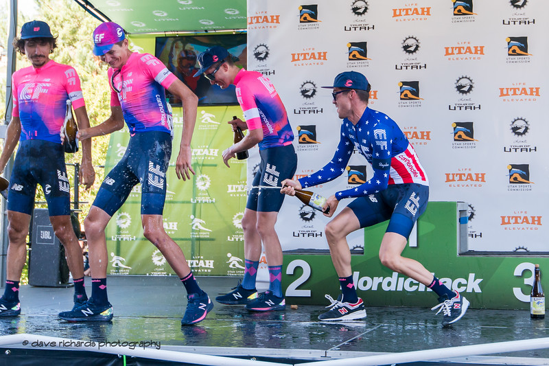 The suds are flying as Alex Howes sprays his EF Education First teammates celebrating their win as overall best team for the 2019 LHM Tour of Utah (Photo by Dave Richards, daverphoto.com)