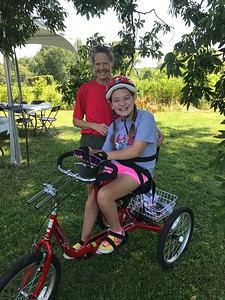 Lexi - on bike, Terri - volunteer