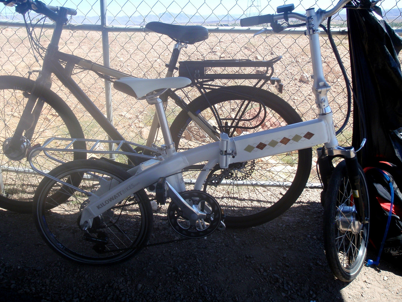 Folding electric assist bike.  Battery is inside top tube