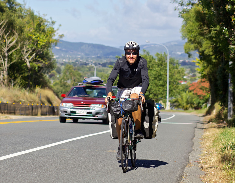 """Thomas Andersen climbing out of Upper Hutt on his ride to Auckland. <br /> <br /> Thomas left Copenhagen in late 2010 and is half way to achieving his goal of cycling the globe. That is what I call amazing, total 100%  respect for what Thomas is doing.<br /> <br /> See  <a href=""""http://www.cyclingtheglobe.com"""">http://www.cyclingtheglobe.com</a>"""