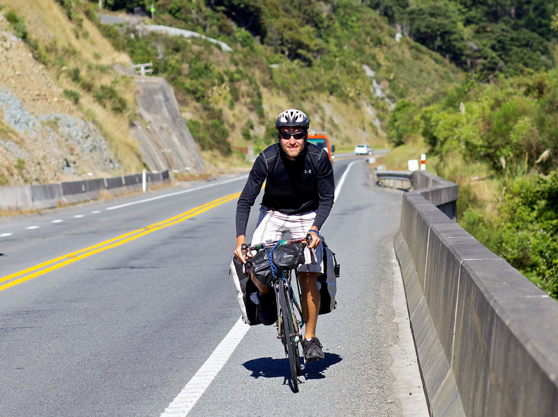 """Thomas climbing the steep hill adjacent Upper Hutt's Twin Lakes, just north of Te Marua.<br /> <br /> Thomas left Copenhagen in late 2010 and is half way to achieving his goal of cycling the globe and is presently heading to Auckland after completing the South Island portion of his trip.<br /> <br /> See  <a href=""""http://www.cyclingtheglobe.com"""">http://www.cyclingtheglobe.com</a>"""