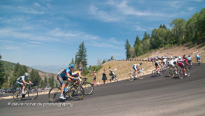 The pack rounds a steep hairpin turn on the Wolf Creek Ranch climb