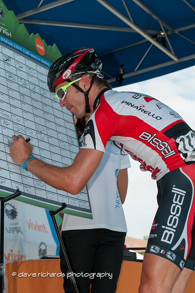 Ben Jacques-Maynes of BISSELL Pro Cycling signing in