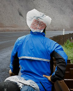Cold and wet, but thankful for a helmet cover. Howard Neckel