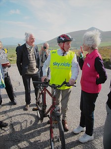 A 90-year old bicyclist gets last minute advice and encouragement for a Sky Ride in Ireland. Pat Elson