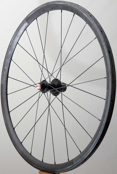 Alchemy Elf front hub<br /> Zipp 202 tubular rim<br /> Sapim CX-RayCX-Speed spokes<br /> alloy nipples<br /> <br /> Set weighs 32g less than stock, are laterally stiffer, and have better hubs.