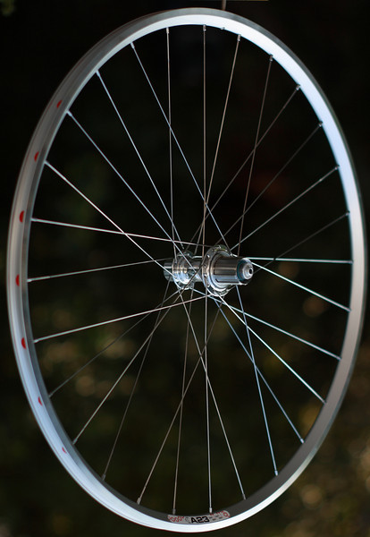 White Industries H3 hub<br /> Velocity A23 rim<br /> Sapim Laser/Wheelsmith DB14 spokes<br /> alloy nipples