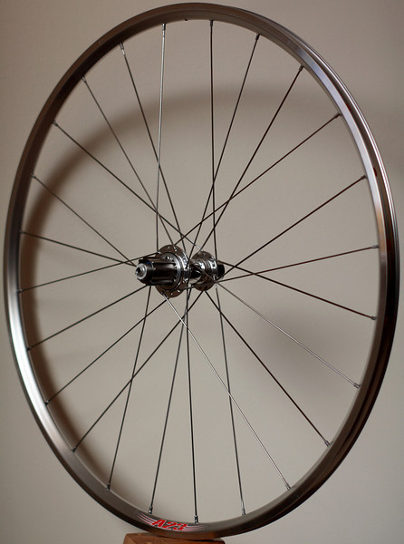 White Industries H3 hub<br /> Velocity A23 rim<br /> Sapim CX-Ray/Wheelsmith DB14 spokes<br /> alloy nipples