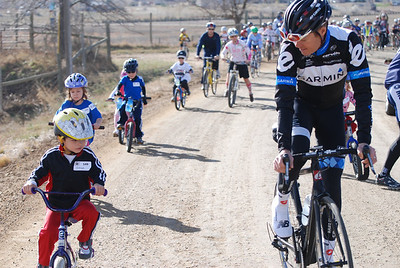 Tom Danielson rides with 4 year old Ethan Rathke of Boulder, CO.  Ethan was one of the 22 junior riders that were 6 years old or younger.  @2011deirdremoynihan