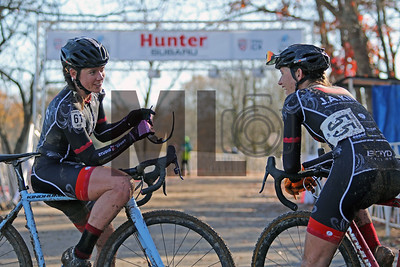 Allison Arensman (61) and Hannah Arensman (55) catch up after the NC Cyclocross North Carolina Grand Prix at Jackson Park in Hendersonville, N.C., on Sunday, Nov. 24, 2019