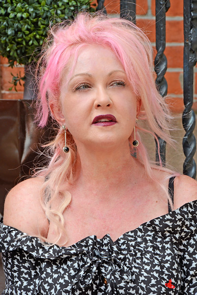 """COBBLE HILL, BROOKLYN, NEW YORK - JULY 29: """"On the stoop"""" with Cat Greenleaf and pop star Cyndi Lauper on July 29, 2015 in Brooklyn, New York. (Photo by Lukas Maverick Greyson)"""