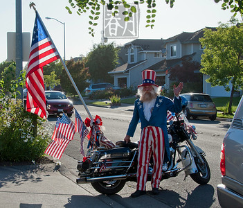 UncleSam-MotorcyclistWaving-h2885crop