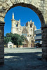 The Lala Mustafa Pasha Mosque, formerly the St. Nicholas Cathedral as seen through the archway of the Venetian Palace in Famagusta, Cyprus.