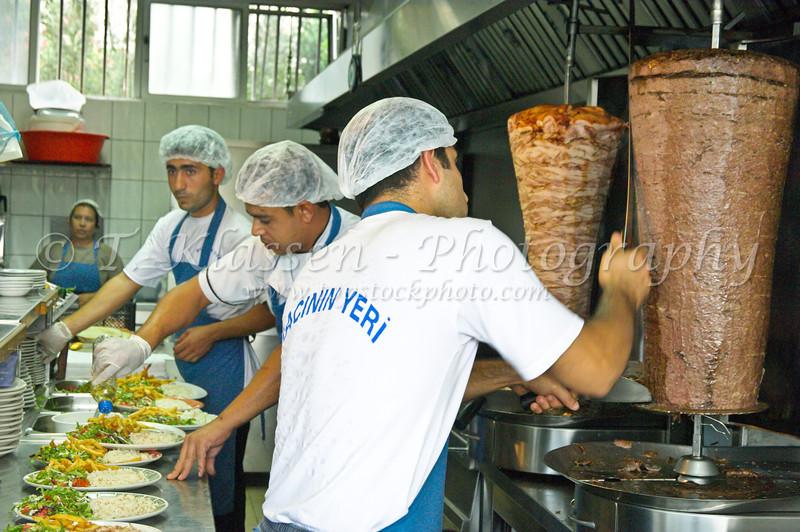 Preparing plates of food at the Temel Reis fast food restaruant in Famagusta, Cyprus.