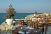 Restaurant tables overlooking the Mediterranean Sea at the Jasmine Court Hotel in Girne, Cyprus.