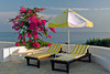 Poolside umbrellas and loungers at the Jasmine Court Hotel in Girne, Cyprus.