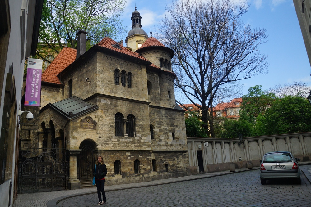 Audrey standing outside of a synagogue in the Jewish Quarter of Prague