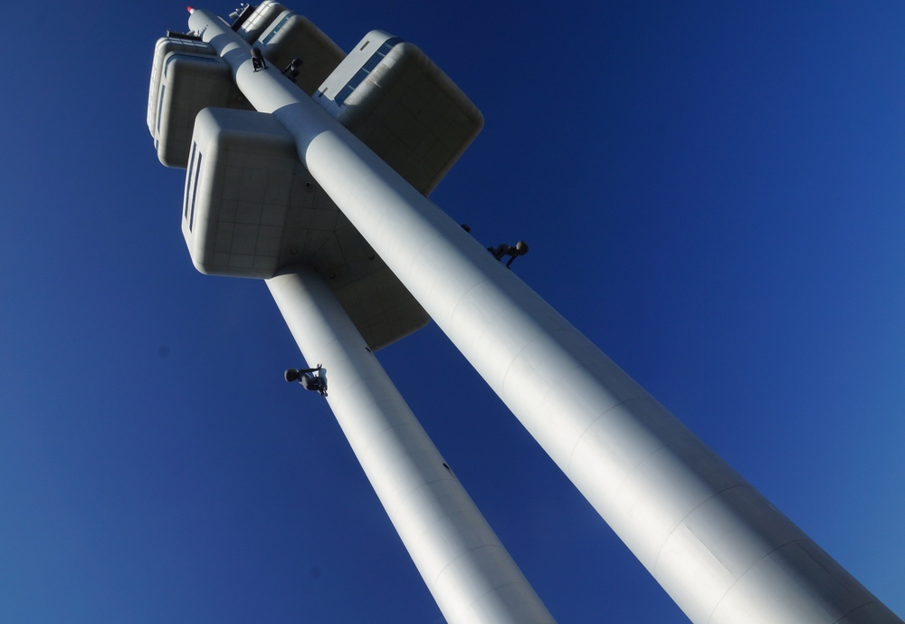 Prague TV Tower with babies crawling up and down it