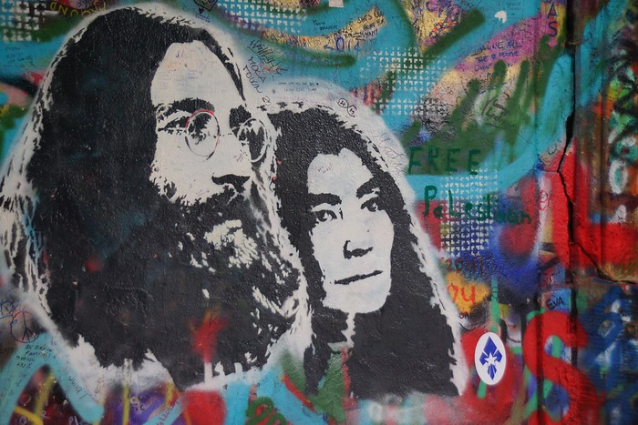 A portrait of John Lennon and Yoko Ono at the Lennon Wall in Prague.