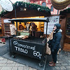 Warming up next to the trdlo stand in the cathedral courtyard of Prague Castle