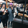 Emilie and Melanie enjoying trdlos and hot cider in the cathedral courtyard of Prague Castle
