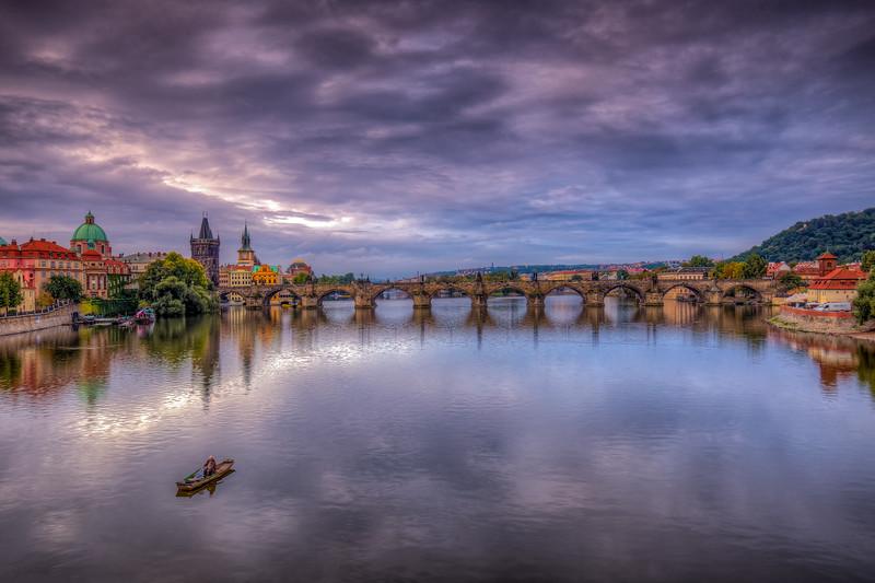 Fisherman In Vtlava River, Prague