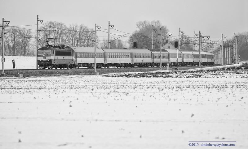A České Dráhy train crosses the field at Pardubice-Opočínek.