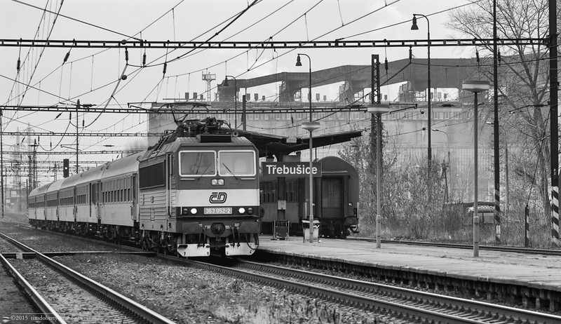Trains pass under the shadow of the massive power plant at Trebusice on the line between Cheb and Usti nad Labem.