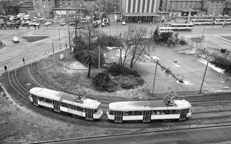 A pair of Tatra trams travel the loop in front of the main station in Olomouc.