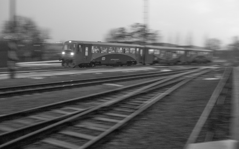 České dráhy railcars arrive at Praha-Ruzyně. These railcars provide suburban service between Praha Masarykovo nádraží and Kladno.