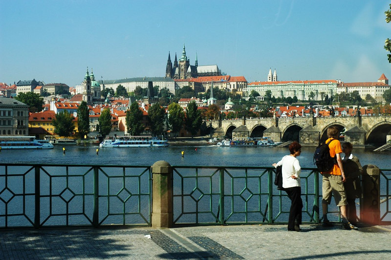 A view from the tour bus: Vltava River and the historical Prague Castle on the high ground (hill)at the far end across the river.