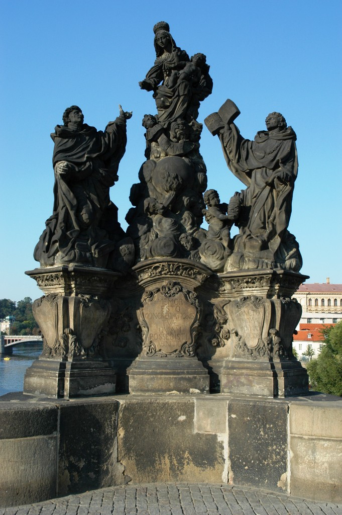 The statues on Charles Bridge - Karlov Most  One of the most touristic places in Prague; street painters and vendors fill up the scene with life and colors.  In 1357, Charles IV started with the construction of this bridge, as some years before, the old one collapsed.  Until 1683, no statues were found along the bridge; first one was of St. Nepomuk, more 'joined' him. Today some 30 look down on the pedestrians.