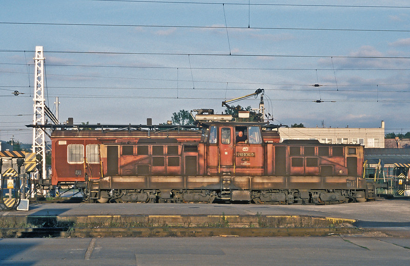 AC overhead electric heavy shunter 210-036 goes about its business in the evening light at Ceske Budejovice on 22 September 2005