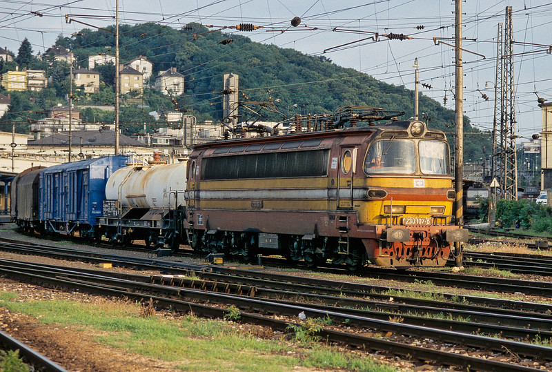 Czech Class 230 locos are frequent visitors on freight - 230.107 passes through the station with a freight and can be seen to be wearing the CD Cargo stickers for its current owners