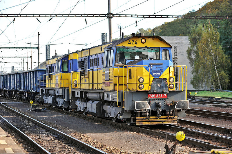 The combined fleets of several private companies are now combined under the banner of 'Advanced World Transport' - AWT. Former OKD locos 740-424 and 740-422 run through the yard at Kralupy nad Vitavou on 22 October 2010
