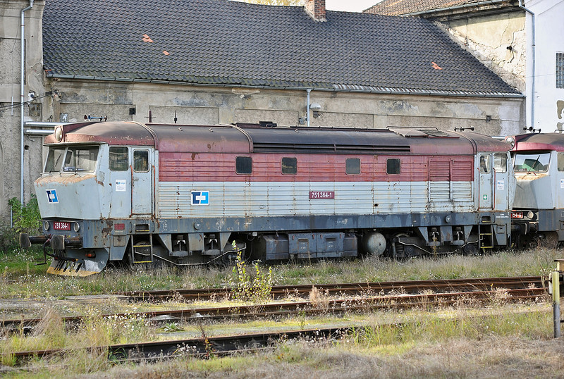 A very run down 751-364 idles away at the depot alongside Kralupy nad Vitavou station on 22 October 2010