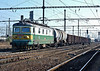 Still in an older livery CD Cargo 122-049 heads north through Nymburk on 23 October 2010