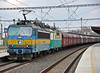 CD Cargo 363-041 and 130-005 haul a hopper train through Kolin on 23 October 2010