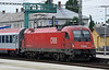 OBB 1216-210 runs into the station with EC78, the 05:39 from Graz to Praha HN