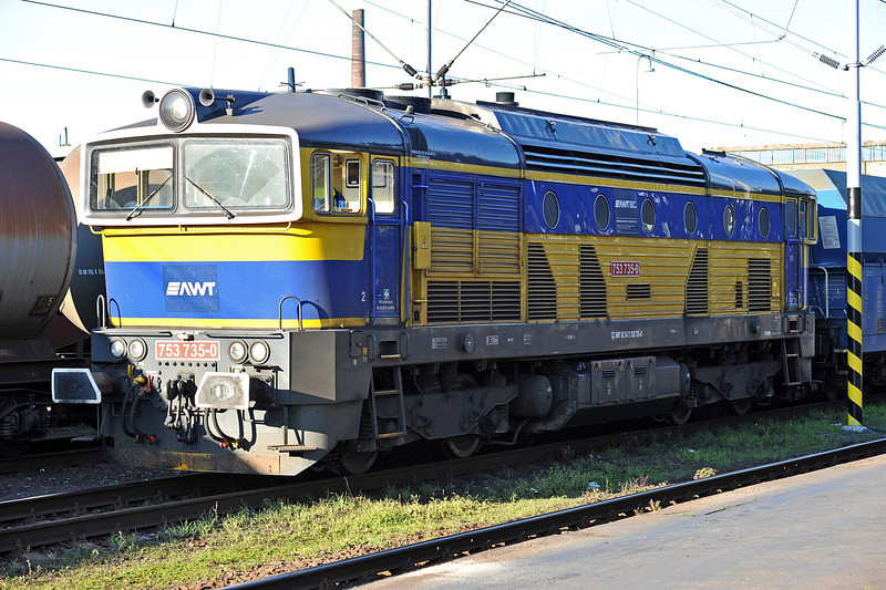 AWT 753-735 sits alongside the platforms at Ostrava with one of the many coal trains they run in the area on 28 September 2011
