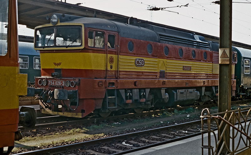 With little room to work in a pole from the station platform canopy is, inevitably, in the way. CSD 754-026 is at Ceske Trebova on 30 October 1991