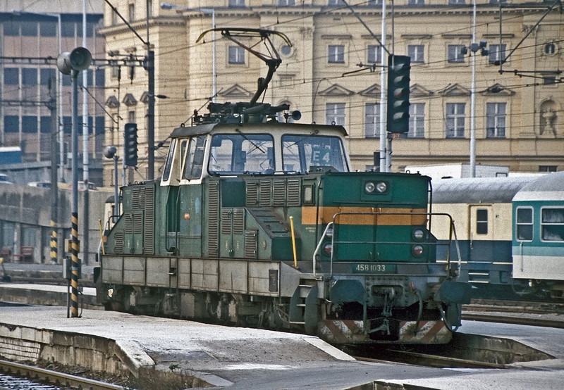 Still wearing its old number (458-1033) CSD 110-033 is one of the station pilots at Praha Hlavni on 30 October 1991