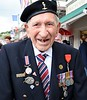 Royal Signals veteran, Arromanches, Normandy, 5 June 2019.  On his right lapel he is wearing the Military Medal awrded to hs father for gallantry in the First World War.
