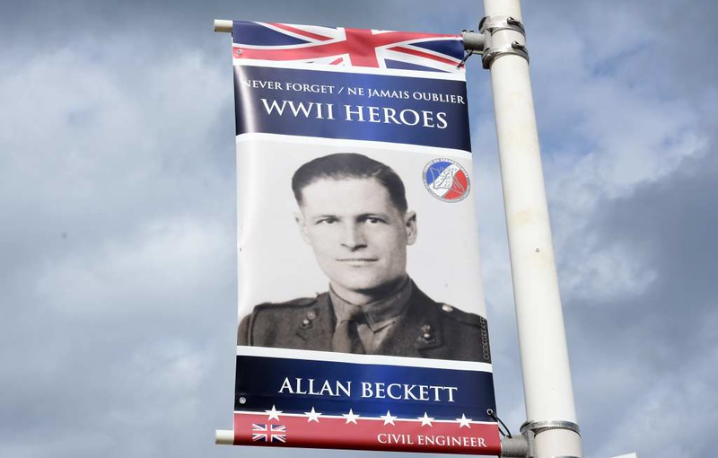 Remembering Alan Beckett, Arromanches, Normandy, 5 June 2019.  Beckett invented the Whale pontoon and the Kite anchor, both essential parts of the Mulberry harbour.  These 'Remembering WWII heroes' signs were everywhere.