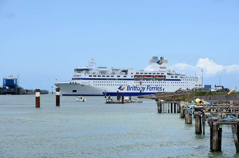 Normandie, Ouistreham, Normandy, 8 June 2019.  The Brittany Ferry from Portsmouth turns in the mouth of the River Orne.