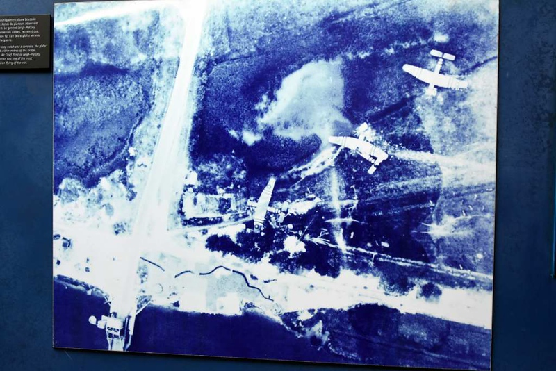 Pegasus Bridge glider assault, Benouville, Normandy, 8 June 2019 3.   1944 photo in the Pegasus Memorial showing the three gliders very close to their objective, Pegasus Bridge, seen at bottom left.
