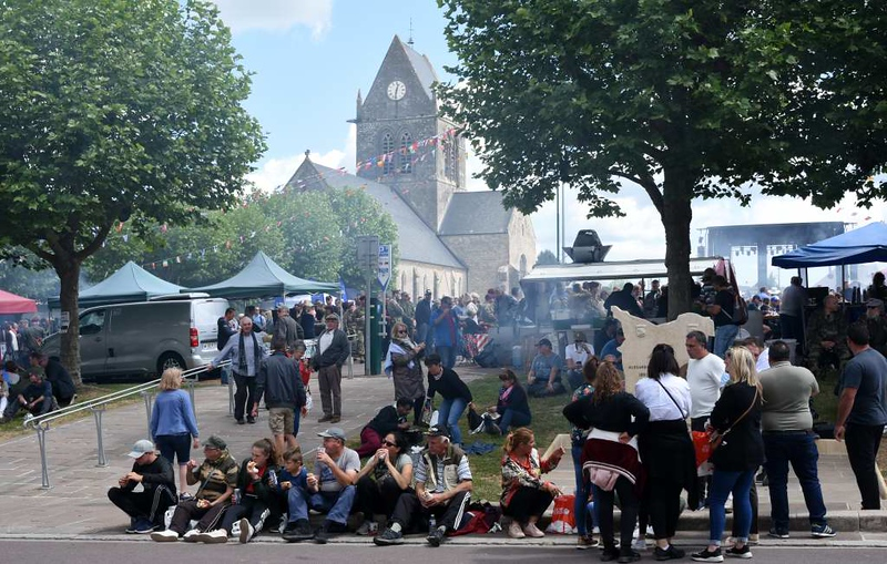 Ste Mere Eglise, Normandy, 6 June 2019 2.  As might be expected, the village was crowded on the exact 75th anniversary of D-Day.  The smoke came from fast food stalls.